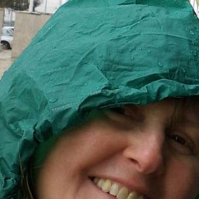 Sue green raincoat very cropped