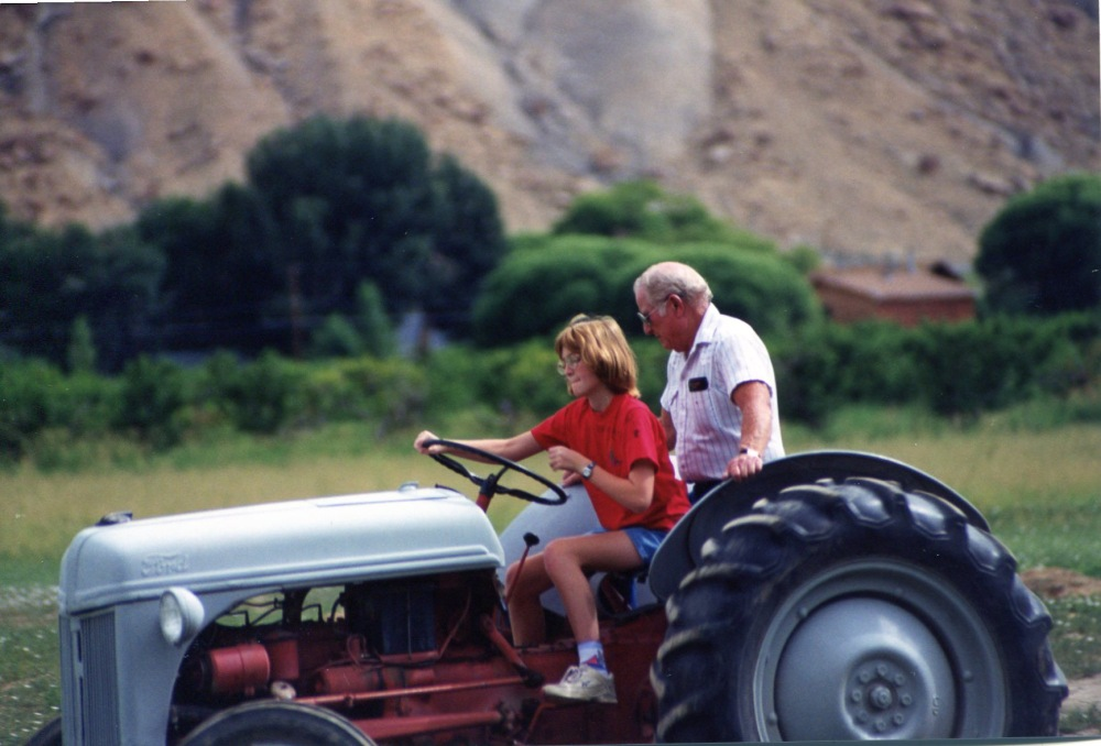 Jenn driving Uncle Chucks tractor 1996
