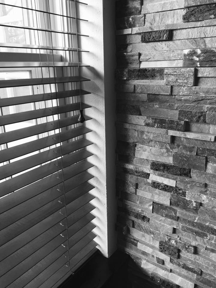 stone wall and horizontal blinds at church